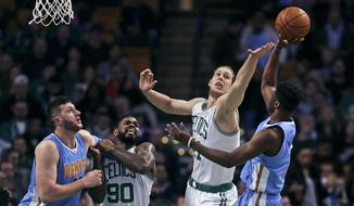 Boston Celtics center Kelly Olynyk tries to block a shot by Denver Nuggets guard Emmanuel Mudiay, right, during the first quarter of an NBA basketball game in Boston, Wednesday, Jan. 27, 2016.  At left are Nuggets center Jusuf Nurkic, and Celtics forward Amir Johnson (90). (AP Photo/Charles Krupa)