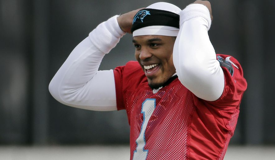 Carolina Panthers quarterback Cam Newton jokes with teammates during practice for the NFL football team in Charlotte, N.C., Wednesday, Jan. 27, 2016.  The Panthers will meet the Denver Broncos in Super Bowl 50 in Santa Clara, Calif., on Feb. 7. (AP Photo/Chuck Burton)