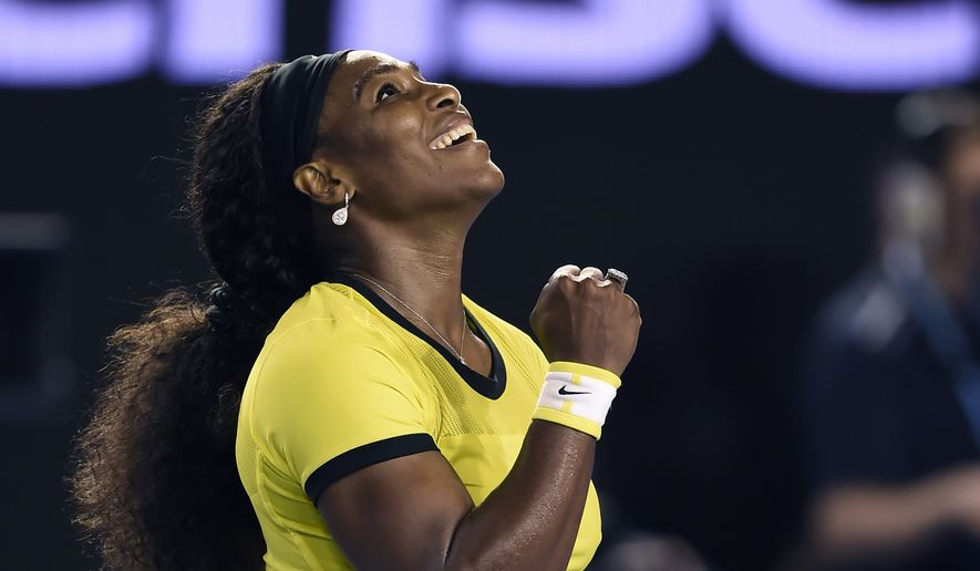 Serena Williams of the United States celebrates after defeating Agnieszka Radwanska of Poland in their semifinal match at the Australian Open tennis championships in Melbourne, Australia, Thursday, Jan. 28, 2016.(AP Photo/Andrew Brownbill)