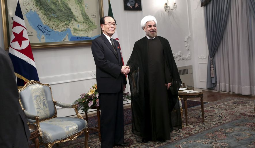 Kim Yong-nam (left), North Korea's No. 2 political leader and head of its legislature, has been meeting with Iranian President Hassan Rouhani. The length of a visit in August raised alarm bells in Washington. (Associated Press/File)