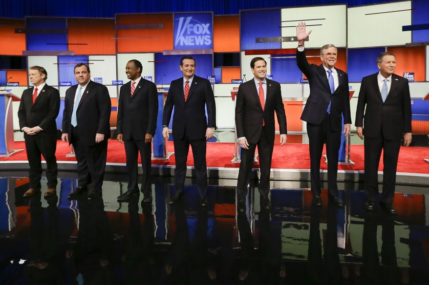 Republican presidential candidates Rand Paul, Chris Christie, Ben Carson, Ted Cruz, Marco Rubio, Jeb Bush and John Kasich stand for a group photo before the Republican debate Thursday in Des Moines, Iowa. (Associated Press)