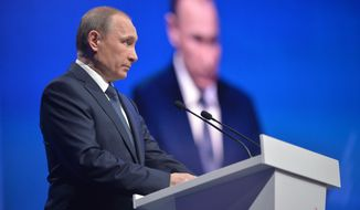 """Russian President Vladimir Putin addresses a regional meeting of pro-Kremlin United Peoples' Front in Stavropol, on Monday, Jan. 25, 2016. Putin has said that the Russian air campaign in Syria will last for as long as it's necessary to support the Syrian army's offensive. During a meeting with students on a visit to Stavropol in southern Russia, he said Moscow's goal is to help Damascus defeat """"terrorists."""" (Alexei Druzhinin/Sputnik, Kremlin Pool Photo via AP)"""