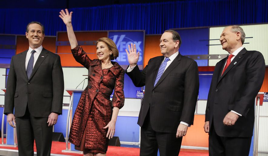 """Republican presidential candidates Rick Santorum, Carly Fiorina, Mike Huckabee and Jim Gilmore stand for a group photo before the Republican """"undercard"""" debate on January 28, 2016 in Des Moines, Iowa. Mr. Santorum and Ms. Fiorina are scheduled to meet with their former rival, President-elect Donald Trump, at his Trump Tower office on Monday, Dec. 12, 2016.  (Associated Press) **FILE**"""