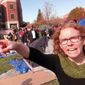 Melissa Click, an assistant professor in the University of Missouri's communications, gestures during a run-in with student journalists on Nov. 9, 2015, at a campus protest that followed the resignations of the university system's president and the Columbia campus' chancellor in Columbia, Missouri. (Associated Press)