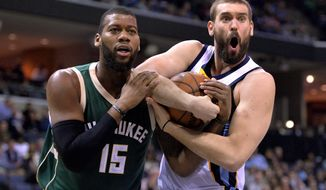 Milwaukee Bucks center Greg Monroe (15) and Memphis Grizzlies center Marc Gasol look to a referee as they struggle for control of the ball in the first half of an NBA basketball game Thursday, Jan. 28, 2016, in Memphis, Tenn. (AP Photo/Brandon Dill)
