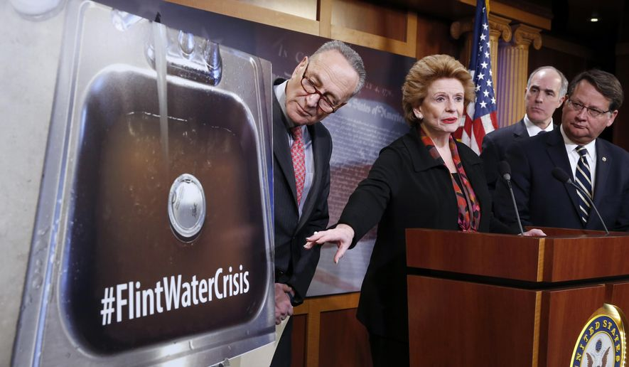 Sen. Debbie Stabenow, D-Mich., second from left, accompanied by, from left, Sen. Charles Schumer, D-N.Y., Sen. Bob Casey, D-Pa., and Sen. Gary Peters, D-Mich., discusses proposed legislation to help Flint, Mich. with their current water crisis, Thursday, Jan. 28, 2016, during a news conference on Capitol Hill in Washington. (AP Photo/Alex Brandon)