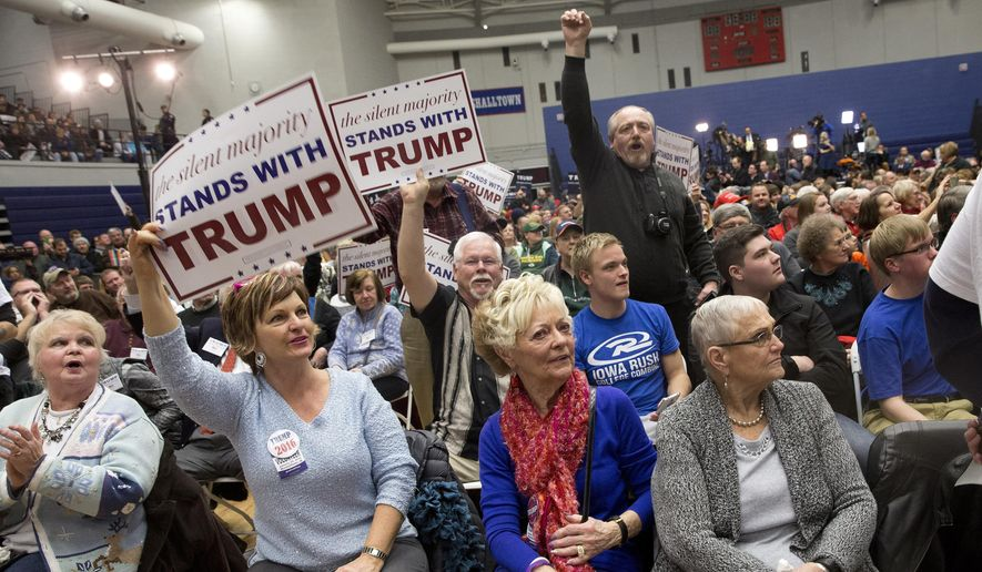 In this Jan. 26, 2016, photo, supporters of Republican presidential candidate Donald Trump cheer to drown out protestors chants during a campaign event at the Roundhouse Gymnasium, in Marshalltown, Iowa.  (AP Photo/Mary Altaffer) **FILE**