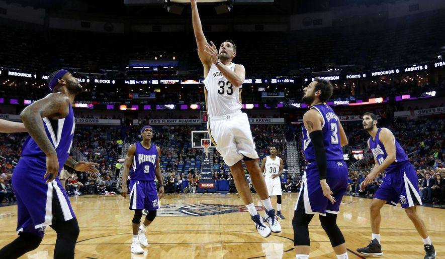 New Orleans Pelicans forward Ryan Anderson (33) goes to the basket against Sacramento Kings guard Marco Belinelli (3) during the first half of an NBA basketball game in New Orleans, Thursday, Jan. 28, 2016. (AP Photo/Gerald Herbert)
