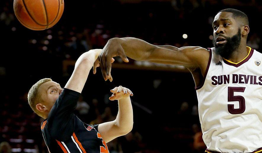 Arizona State's Obinna Oleka (5) knocks the ball away from Oregon State's Olaf Schaftenaar during the first half of an NCAA college basketball game, Thursday, Jan. 28, 2016, in Tempe, Ariz. (AP Photo/Matt York)
