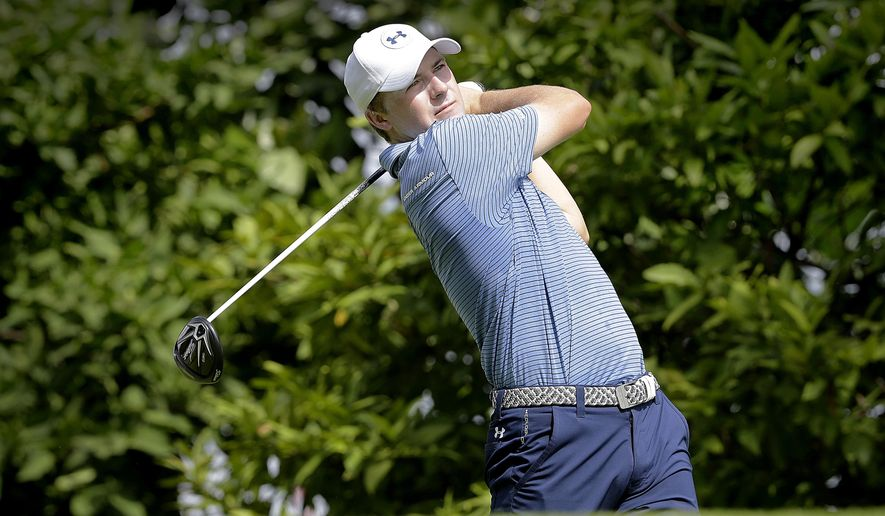 Jordan Spieth of the United States tees off on the third hole during the first round of the SMBC Singapore Open golf tournament held at the Sentosa Golf Club's Serapong Course on Thursday, Jan. 28, 2016, in Singapore. (AP Photo/Wong Maye-E)