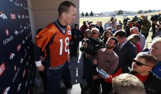 Denver Broncos quarterback Peyton Manning takes the podium to respond to questions after an NFL football practice at the team's headquarters, Thursday, Jan. 28, 2016, in Englewood, Colo. The Broncos are preparing to face the Carolina Panthers in Super Bowl 50 on Sunday, Feb. 7. (AP Photo/David Zalubowski)