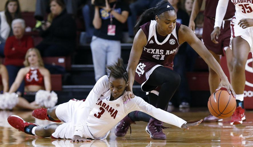 Alabama guard Khadijah Carter (3) fights for a loose ball with Texas A&M guard/forward Jasmine Lumpkin (21) during the first half of an NCAA college basketball game, Thursday, Jan. 28, 2016, in Tuscaloosa, Ala. (AP Photo/Butch Dill)