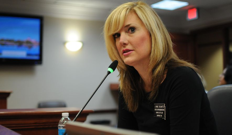 Republican Rep. Lynne DiSanto testifies on Thursday, Jan. 28, 2016, in a state House committee at the Capitol in Pierre, S.D. DiSanto's proposal to require adult welfare applicants under age 65 to pass drug tests before receiving food stamps or cash assistance was shot down. (AP Photo/James Nord)