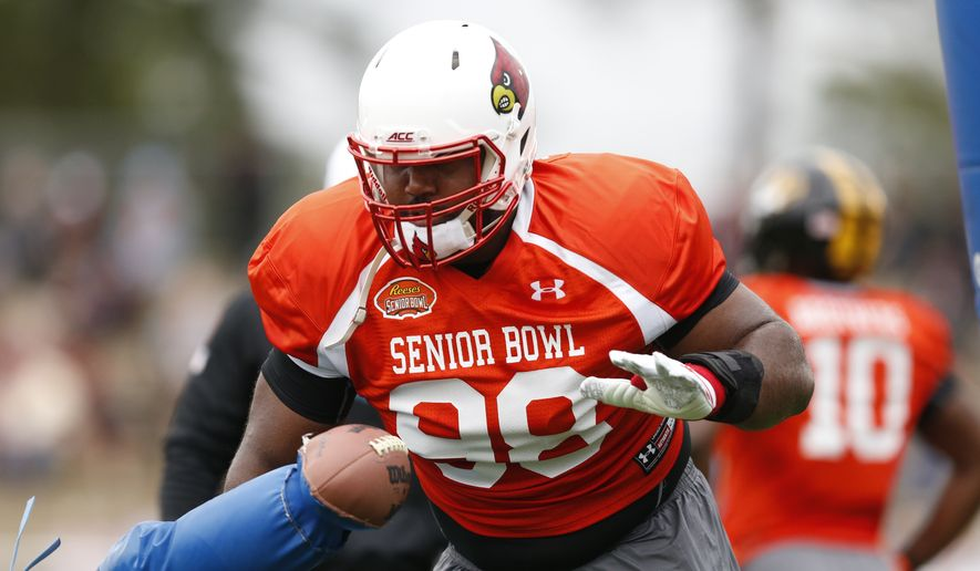 Louisville defensive end Sheldon Rankins (98) runs through drills during NCAA college football practice for the Senior Bowl, Tuesday, Jan. 26, 2016, at Fairhope Municipal Stadium, in Fairhope, Ala.(AP Photo/Brynn Anderson)