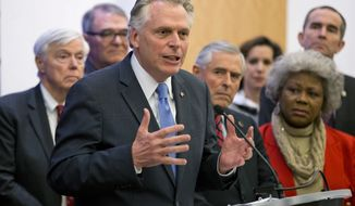 Virginia Gov. Terry McAuliffe is joined by members of the House and Senate as he announces a compromise on a set of gun bills at the Capitol in Richmond, Va., Friday, Jan. 29, 2016.   (AP Photo/Steve Helber)