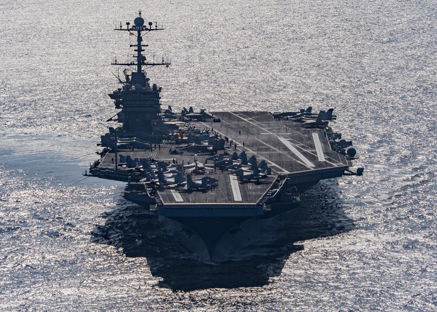 In this Friday, Dec. 25, 2015, file photo released by the U.S. Navy, the aircraft carrier USS Harry S. Truman navigates the Gulf of Oman. (Mass Communication Specialist 3rd Class J. M. Tolbert/ U.S. Navy via AP) ** FILE **