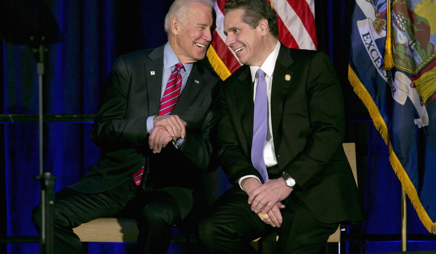 Vice President Joe Biden talks with New York Gov. Andrew Cuomo during a rally on the economy,  Friday, Jan. 29, 2016, in New York.  (AP Photo/Richard Drew)
