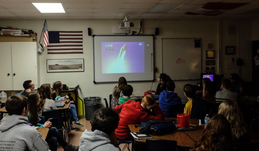 Eighth grade students watch a video of Challenger space shuttle launch Thursday, Jan. 28, 2016,  at Christa McAuliffe Middle School in Bangor Township, Mich. The students were learning about the teacher-astronaut, whom the school is named after.  Thursday marks the space shuttle accident's 30th anniversary. Andrew Dodson/The Bay City Times via AP) LOCAL TELEVISION OUT; LOCAL INTERNET OUT; MANDATORY CREDIT