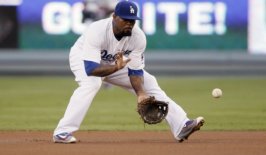 FILE - In this Oct. 3, 2015, file photo, Los Angeles Dodgers second baseman Howie Kendrick fields a ground ball against during the first inning of a baseball game against the San Diego Padres in Los Angeles. A person familiar with the deal has told The Associated Press that the Dodgers and free-agent Kendrick have agreed to a $20 million, two-year contract. The person spoke on the condition of anonymity Friday, Jan. 29, 2016, because the team has not announced the agreement. (AP Photo/Danny Moloshok, File)