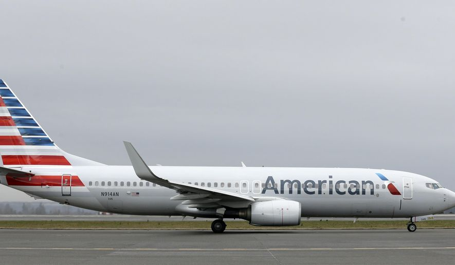 In this Tuesday, Jan. 26, 2016, photo, an American Airlines flight taxis at Seattle-Tacoma International Airport in Seattle. American reports financial results Friday, Jan. 29, 2016. (AP Photo/Ted S. Warren)