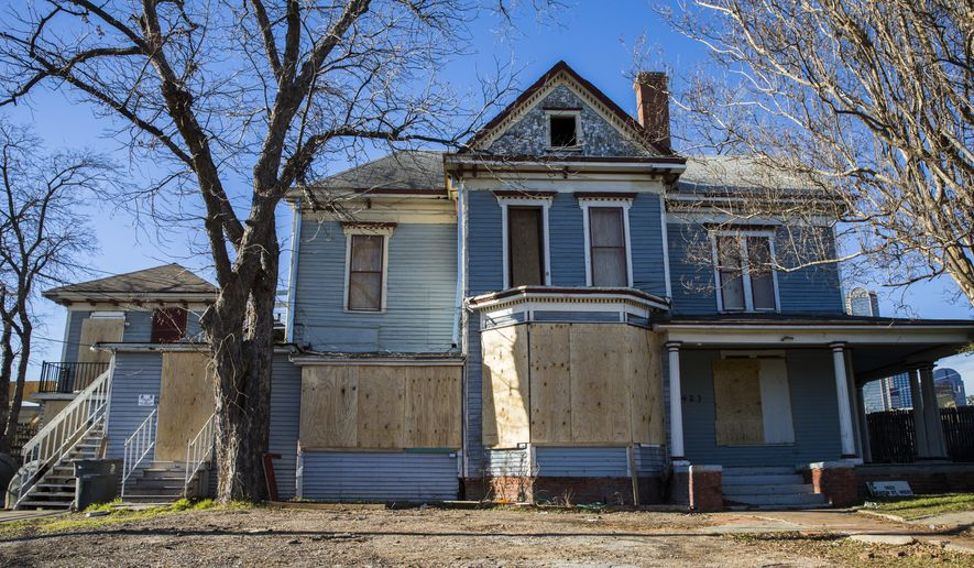 This Thursday, Jan. 28, 2016 photo shows a Victorian house at 1438 Griffin Street West that Time Warner has agreed to pay to move in Dallas. In a city where history lasts as long as it takes to crank up the bulldozer, this truly is big and breaking news: One of the oldest houses in The Cedars has been granted a stay of execution. (Ashley Landis/The Dallas Morning News via AP) MANDATORY CREDIT; MAGS OUT; TV OUT; INTERNET USE BY AP MEMBERS ONLY; NO SALES