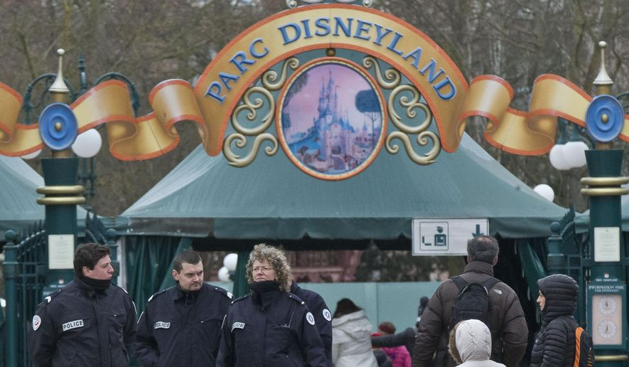 French police officers patrol outside Disneyland Paris, in Marne-la-Vallee, east of Paris, Friday, Jan. 29, 2016. (AP Photo/Michel Euler)