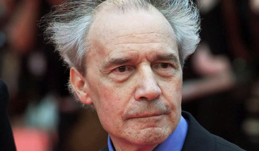 "FILE - This Wednesday, May 16, 2001 file picture shows French director Jacques Rivette arriving for the screening of his film ""Who Knows"", in competition at the Film Festival in Cannes, France. French director Jacques Rivette, a secretive pioneer of convention-bashing New Wave film who brought renown to women actors such as Emmanuelle Beart, has died at 87. (AP Photo/Michel Euler, File)"
