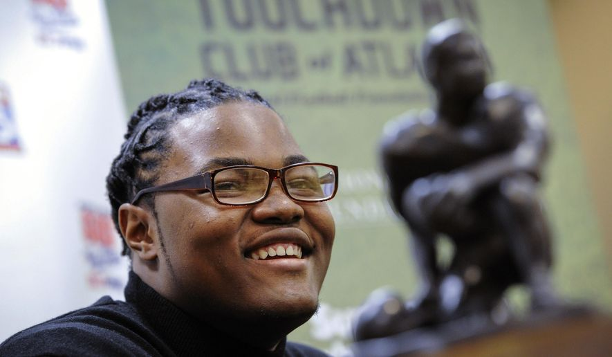 FILE - In this Thursday, Jan. 28, 2016, file photo, Rashan Gary, of Paramus, N.J., talks to members of the media in Atlanta, while on hand to receive the Bobby Dodd national high school lineman of the year award at the Touchdown Club of Atlanta. The defensive tackle from Paramus Catholic High School in New Jersey and most-wanted recruit in the country is weighing whether to play for one of those Southern power programs such as Alabama and Clemson or head to Michigan to be part of the Wolverines' rebirth under Jim Harbaugh. (AP Photo/John Amis, File)