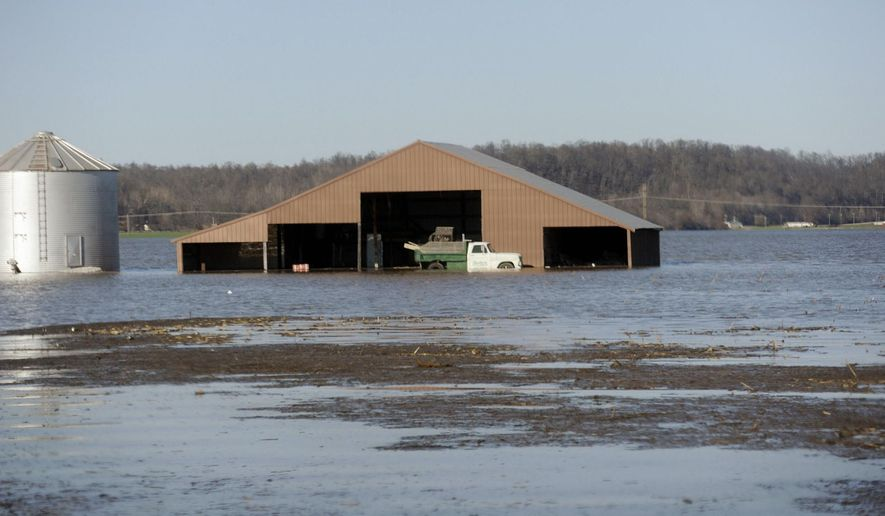 This Jan. 1, 2016 photo shows a farm surrounded by floodwaters in Olive Branch in southern Illinois. Some southern Illinois residents who by now expected to live in new homes after agreeing to government buyouts following the 2011 Mississippi River flood instead got socked a second time amid the prolonged political fight over the state's budget. Alexander County officials estimate that several dozen homes approved for buyouts suffered further damage from early-winter floods on the Mississippi and its tributaries in Missouri and Illinois in late December 2015 and early January. (Glenn Landberg/Southeast Missourian via AP)