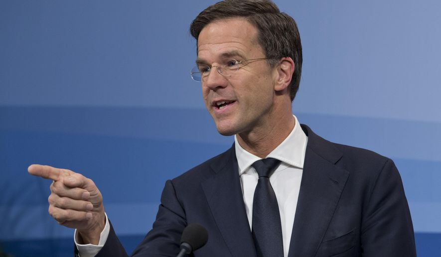Dutch Prime Minister Mark Rutte explains the cabinet decision to extend its campaign to extend Dutch air strikes from Iraq into Eastern Syria during a press conference after a cabinet meeting in The Hague, Netherlands, Friday, Jan. 29, 2016. (AP Photo/Peter Dejong)