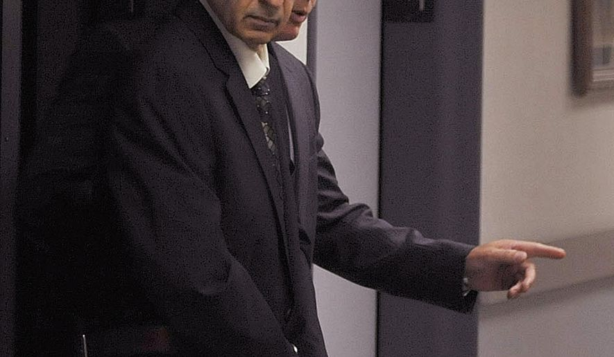 FILE - In this Sept. 9, 2015 file photo, Rev. Joseph Maurizio is led by U.S. Marshals into Federal Court for jury selection in Johnstown, Pa. On Friday, Jan. 29, 2016, a federal judge delayed the sentencing for the 70-year-old Somerset County priest who was convicted in September of having sex with poor street children during missionary trips to Honduras. The judge will instead hold a hearing on sealed motions seeking a new trial. (Todd Berkey/Tribune-Democrat via AP, File)