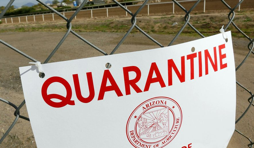 A quarantine warning is displayed outside the horse racing track at Turf Paradise, Friday, Jan. 29, 2016, in Phoenix. Turf Paradise has euthanized one horse and is quarantining two others in the wake of a herpes outbreak that surfaced in New Mexico.(AP Photo/Matt York)