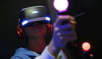 A video game enthusiast experiences a virtual reality headset at the Taipei Game Show 2016 in Taipei, Taiwan, Friday, Jan. 29, 2016. (AP Photo/Wally Santana)