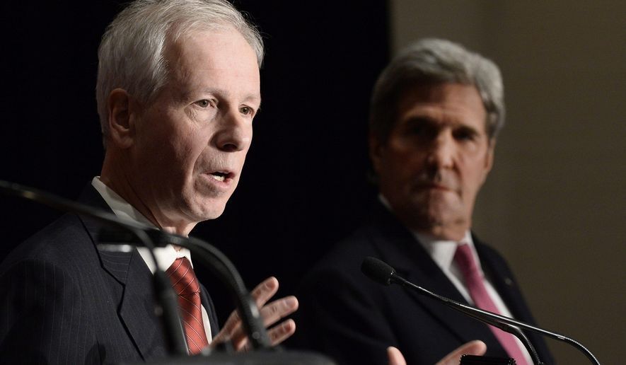 Canadian Foreign Affairs Minister Stephane Dion responds to questions at a news conference at the end of a North American Foreign Ministers Meeting, Friday, Jan. 29, 2016, in Quebec City. U.S. Secretary of States John Kerry, right, looks on. (Jacques Boissinot/The Canadian Press via AP)
