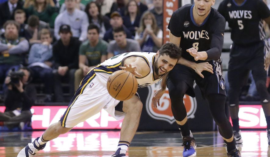 Utah Jazz guard Raul Neto, left, and Minnesota Timberwolves guard Zach LaVine (8) vie for a loose ball during the second quarter of an NBA basketball game Friday, Jan. 29, 2016, in Salt Lake City. (AP Photo/Rick Bowmer)