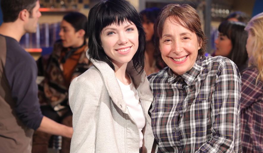 "This image released by Fox shows Carly Rae Jepsen, left, and Didi Conn during a rehearsal for ""Grease: Live."" Conn, who played Frenchy in the 1978 John Travolta-led movie, will make a cameo appearance as a waitress at the Frosty Palace malt shop. Jepsen will play Frenchy in the new production airing Sunday, Jan. 31, on Fox. (Kevin Estrada/FOX via AP)"