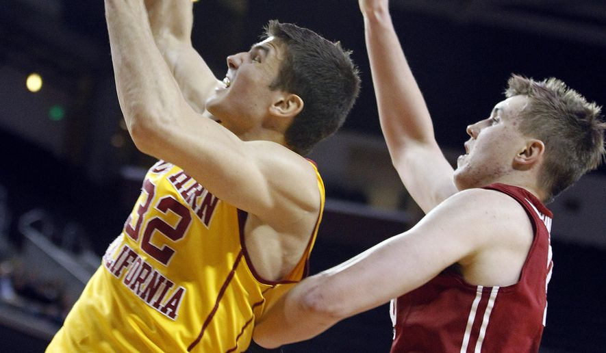 Southern California forward Nikola Jovanovic, left, pulls down a rebound in front of Washington State forward Josh Hawkinson, right, during the first half of an NCAA college basketball game in Los Angeles, Thursday, Jan. 28, 2016. (AP Photo/Alex Gallardo)