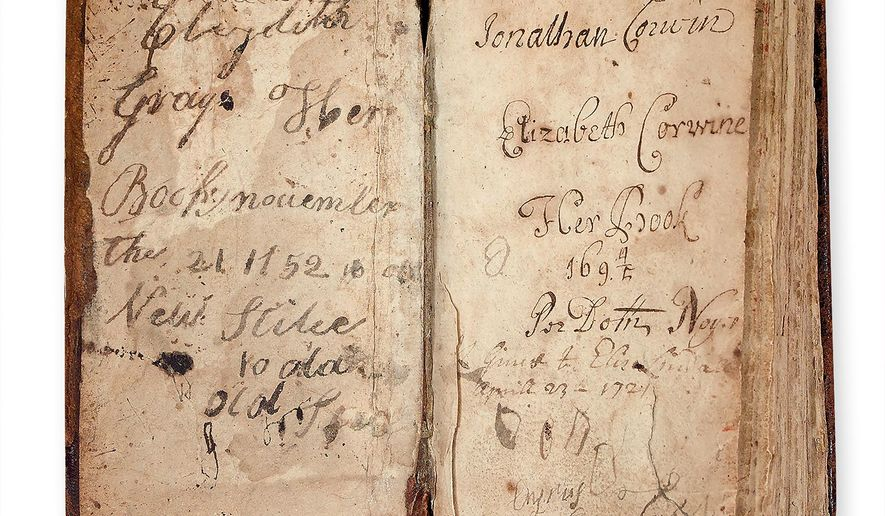 "This 2015 photo provided by Swann Auction Galleries shows the inside cover of the seventh edition of ""The Bay Psalm Book."" The book once belonged to Jonathan Corwin, a judge during the 1692 trials when 19 accused witches were hanged and another was crushed to death in Salem, Mass. It is scheduled to be auctioned on Thursday, Feb. 4, 2016. (Swann Auction Galleries via AP)"