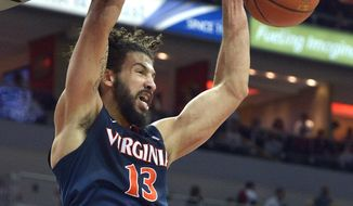 Virginia's Anthony Gill (13) dunks the ball during the second half of an NCAA college basketball game against Louisville, Saturday, Jan. 30, 2016, in Louisville, Ky. Virginia won 63-47. (AP Photo/Timothy D. Easley)