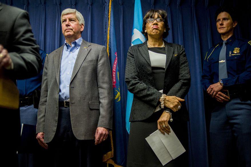 Michigan Gov. Rick Snyder and Flint Mayor Karen Weaver (The Flint Journal-MLive.com via Associated Press/File)