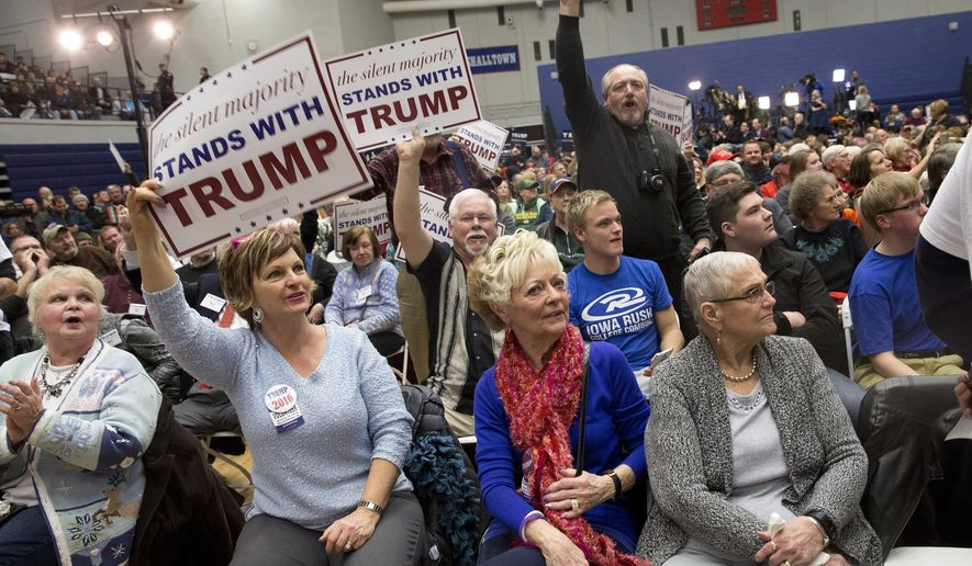 In this Jan. 26, 2016, photo, supporters of Republican presidential candidate Donald Trump cheer to drown out protestors chants during a campaign event at the Roundhouse Gymnasium, in Marshalltown, Iowa.  Trump, Ted Cruz and Bernie Sanders are energizing grassroots voters as the first balloting of the 2016 presidential race draws near. Yet the three maverick contenders are also alarming political operatives over the damage each could wreak on their own parties' House candidates this November. (AP Photo/Mary Altaffer)