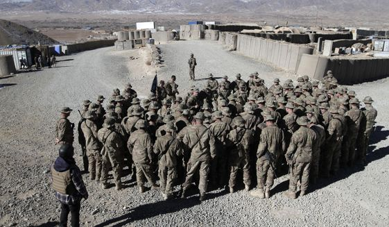 U.S. troops gather into Wardak province, eastern Afghanistan, in this Dec. 25, 2013, file photo. (AP Photo/Rahmat Gul, File)