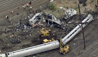 In this Wednesday, May 13, 2015, file photo, emergency personnel work at the scene of a Tuesday night derailment in Philadelphia of an Amtrak train headed to New York. (AP Photo/Patrick Semansky, File)