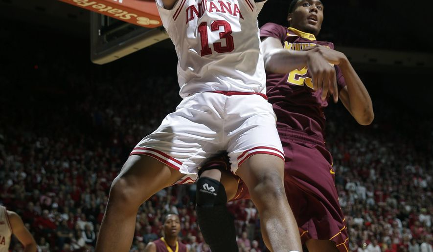 Indiana forward Juwan Morgan (13) goes for a rebound in front of Minnesota forward Charles Buggs (23) in the first half of an NCAA college basketball game in Bloomington, Ind., Saturday, Jan. 30, 2016. (AP Photo/AJ Mast)