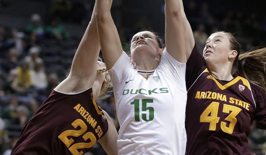 Arizona State's Quinn Dornstauder, left, Oregon's Jacinta Vandenberg, middle, and Arizona State's Eliza Normen reach for a rebound during the first half of an NCAA college basketball game Friday, Jan. 29, 2016, in Eugene, Ore. Arizona State won 63-58. (AP Photo/Ryan Kang)