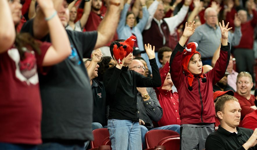 Arkansas fans call the hogs before an NCAA college basketball game against Texas Tech in Fayetteville, Ark., Saturday, Jan. 30, 2016. (AP Photo/Sarah Bentham)
