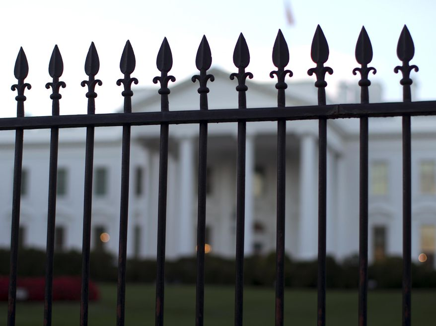 In this Sept. 23, 2014, photo, the White House is seen through the North Lawn perimeter fence in Washington. (AP Photo/Carolyn Kaster) **FILE**