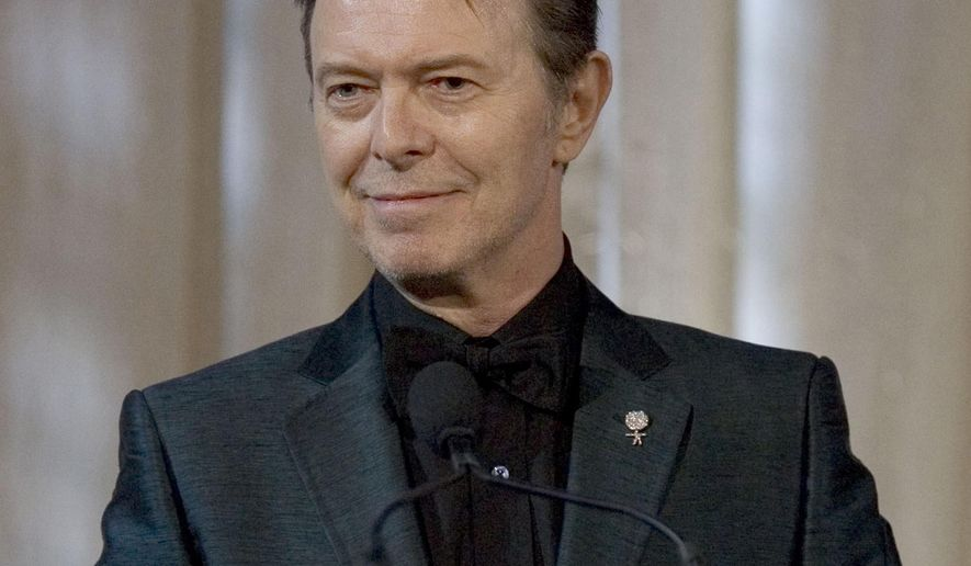 "FILE - In this June 5, 2007 file photo, David Bowie attends an awards show in New York.  Bowie wanted his ashes to be scattered in Bali, ""in accordance with the Buddhist rituals"" and left most of his estate to his widow, the supermodel Iman and his two children, according to his will filed Friday, Jan. 30, 2016.  (AP Photo/Stephen Chernin)"