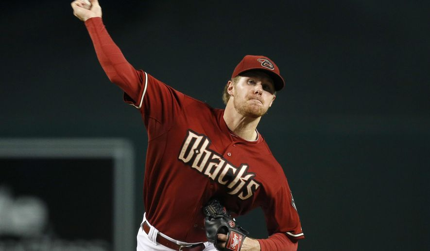 FILE - In this Sept. 30, 2015, file photo, Arizona Diamondbacks starter Chase Anderson throws a pitch against the Colorado Rockies during the first inning of a baseball game in Phoenix. The Diamondbacks have traded Anderson and infielder Aaron Hill to the Milwaukee Brewers for shortstop Jean Segura and righty Tyler Wagner. The Brewers also got minor league shortstop Isan Diaz and cash in the deal announced Saturday, Jan. 30, 2016. (AP Photo/Ross D. Franklin, File)