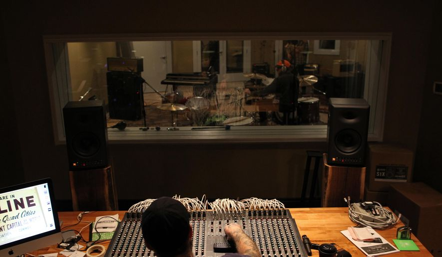 ADVANCE FOR USE SATURDAY, JAN. 30 - In this photo taken Friday, Jan. 15, 2016, sound engineer Mike Gentry prepares for a session with the Nashville-based Keeps at Daytrotter in Davenport, Iowa. (David Scrivner/Iowa City Press-Citizen via AP)  NO SALES; MANDATORY CREDIT